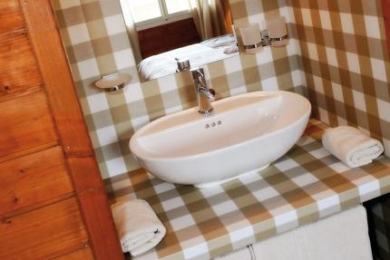 Ferienhäuser Leitner – Waschbecken im Schlafzimmer – Ferienhäuser für Ihren Familienurlaub am Millstätter See in Kärnten