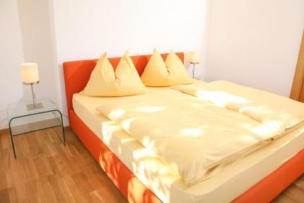 Schlafzimmer Appartement Seerose – Seevilla Cattina – Appartements direkt am Millstätter See in Kärnten