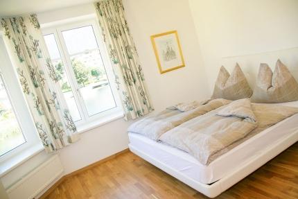 Schlafzimmer Appartement Wasserlilie – Seevilla Cattina – Appartements direkt am Millstätter See in Kärnten
